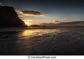 Sunset and wet sand at Worms Head