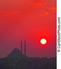 Sunset and Yavuz Selim mosque, Istanbul, Turkey