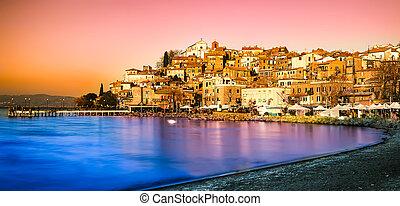 Sunset on Bracciano Lake at Anguillara Sabazia, Lazio, Italy.