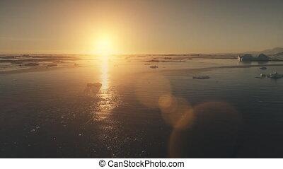 Sunset Antarctica aerial drone flight.