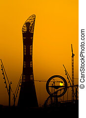 The sun sets behind the Aspire hotel tower in Doha