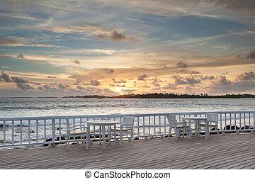 sunset at beach bar, malediven