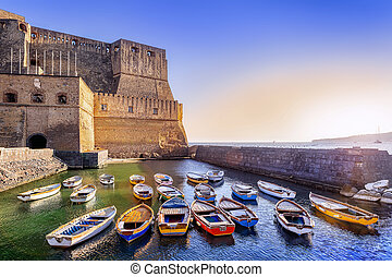 sunset at castel dell?ovo in napoli, italy