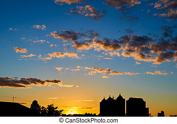 Sunset at city of with building silhouette