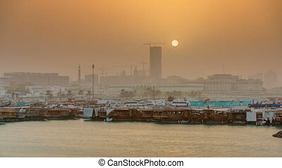 Sunset at Doha Bay timelapse with Traditional Wooden Dhow...