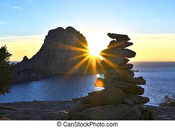 Sunset at Es Vedra with sunbeam.