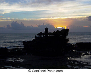 sunset at famous temple Tanah Lot