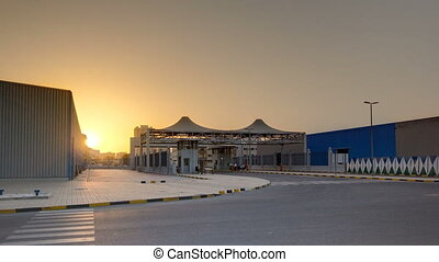 Sunset at free zone of Ajman timelapse. Ajman is the capital...
