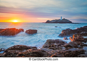 Sunset at Godrevy Cornwall England - The sun setting on the...