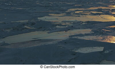 Sunset at Holy Nose Peninsula. Beautiful winter Lake Baikal.