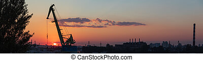 Sunset at industrial district of Kiev in Podil district