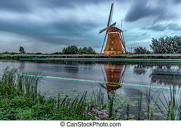 Sunset at Kinderdijk, the windmills farm listed in the UNESCO world heritage sites list at Alblasserdam, nearby Rotterdam, Netherlands