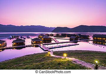 Sunset at Lakeside rafthouse at Srinagarind Dam, Kanchana