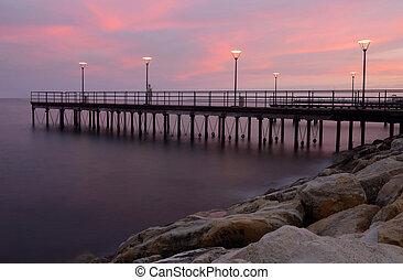 Sunset at Limassol coastal front, Cyprus, Europe. It has ...