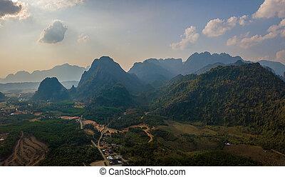 Sunset at Limestone Karsts Mountains Vang Vieng Laos