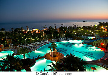 sunset at luxery hotel - luxury hotel with pool at night