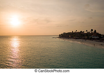 Sunset at Manchebo beach on Aruba island in the Caribbean Sea