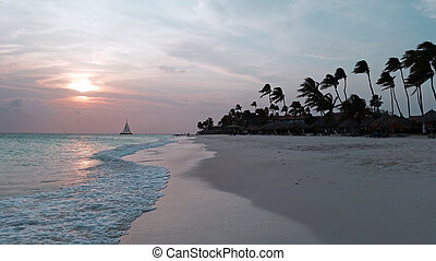 Sunset at Manchebo beach on Aruba island in the Caribbean