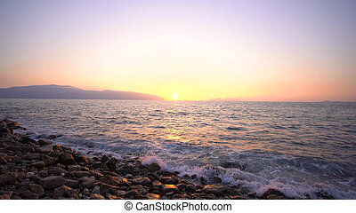 Sunset at Mediterranean sea. Incredible sunset with orange clouds in the sky