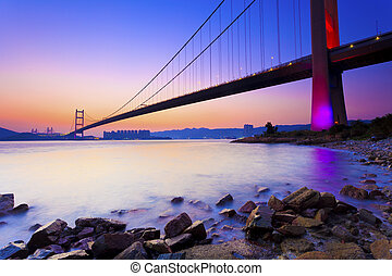 Sunset at modern bridge along coast