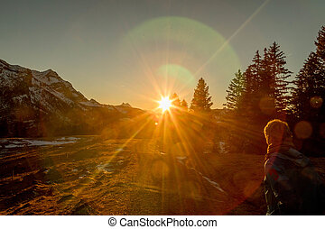 Sunset at Mountain Hike - Woman Hiking Snowy Mountain at...