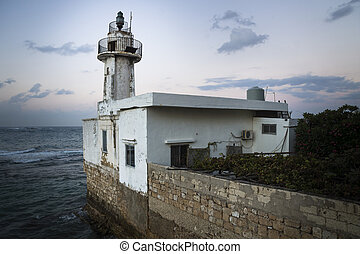 Sunset at old lighthouse in Tyre, Sour, Lebanon