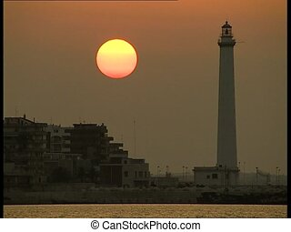 SUNSET at port with lighthouse