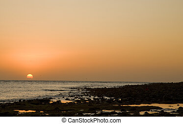Sunset over a rocky beach at Puerto Penasco (Rocky Point) Mexico.