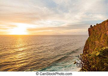 Sunset at Pura Luhur Uluwatu. Bali island, Indonesia.