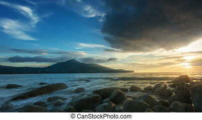 Sunset at rocky shore of the ocean with surf sound. Thailand. Phuket