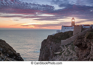 Sunset at sea with a view of lighthouse in Sagres.