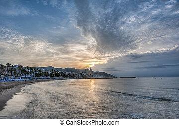 Sunset at Sitges, Spain - Sun sets on Sitges village on...