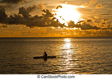 Sunset at South China Sea witn canoe in Phu Quoc close to Duong Dong, Vietnam