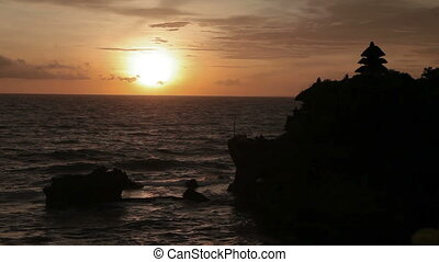 Sunset at Tanah Lot temple. Bali island Indonesia.