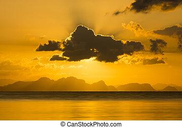 Sunset at the lake in summer season