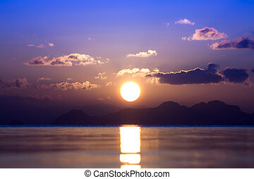 Sunset at the lake in summer season.