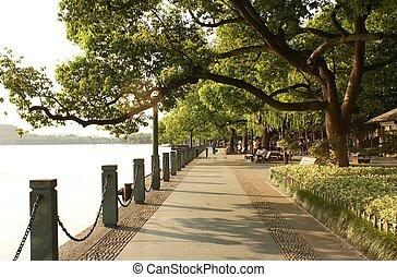 Sunset at the lake - Beautiful park way and embankment at...