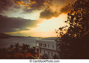 Sunset at the sea on mountain and view On hotel in retro colors. Koh Samui.