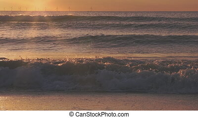 Sunset at the sea with waves