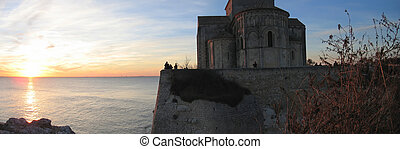 Sunset at the Talmont church above the sea, France, Panorama