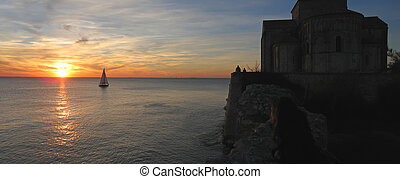 Sunset at the Talmont church with a sailing boat, France, Panorama