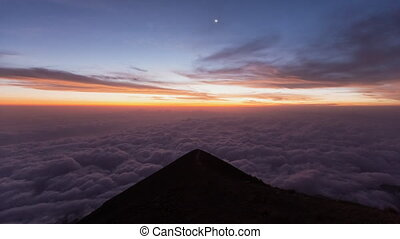 Day to night Timelapse sunset at the top of Agung volcano in clouds Balii Indonesia. over the clouds. sun starsky. fast speed moving. hyperlapse 4k video. rocks and mountains. gunung. milkyway