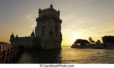 sunset at the tower of belem in lisbon