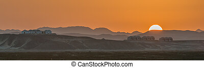 Sunset at Wadi Lahami - The sun setting over the desert ...