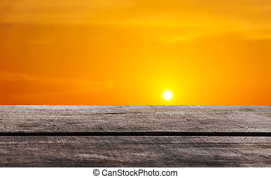 Sunset background with a wooden floor