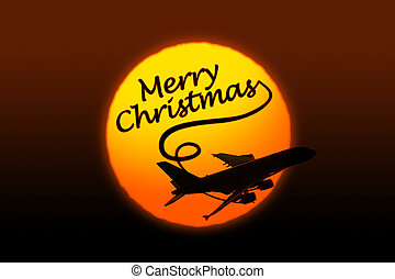 Sunset background with silhouette of airplane and greeting Christmas text