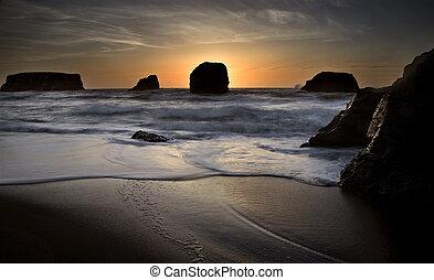 Sunset Bandon Oregon beautiful rock formations USA
