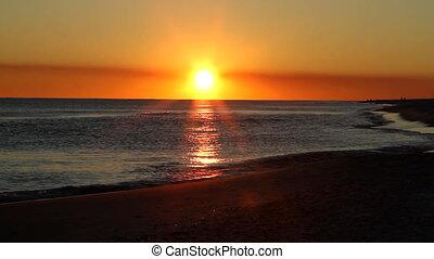 Sunset Beach Waves - The sun begins to set on the horizon...
