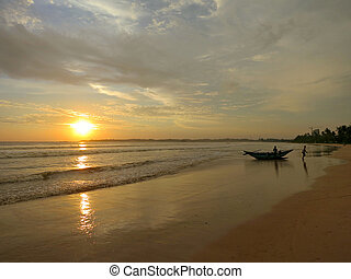 Sunset beach with fisherman boat silhouette in water, Sri Lanka