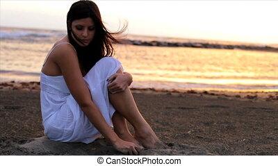 Sunset beautifu woman thinking